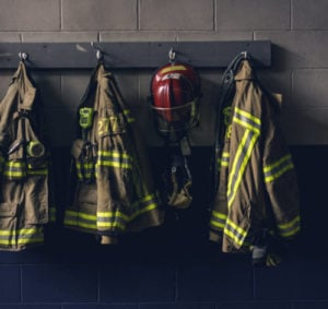 row of firefighter coats